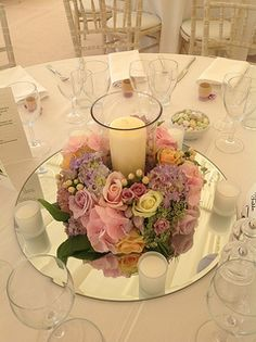 wedding table Corlea, something like this, round mirror replace with square piece.A big candle in middle and small candles surrounding. I like this arrangement. Wedding Table Centres, Wedding Table Centerpieces, Wedding Decorations, Table Wedding, Wedding Mirror, Wedding Table Arrangements, Wedding Mandap, Stage Decorations, Wedding Stage