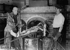 Survivors of the Dachau concentration camp demonstrate the operation of the crematorium by pushing a corpse into one of the ovens.: