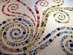 In case it wasn't already obvious, I definitely want spirals in the design.  Here is a mosaic by the artist Brad Teasdale, that I found online.  I think it is amazing.  He actually used concrete as the background, which I would not want to do :-), but it really sets the mosaic off nicely.
