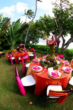 colorful party tables in hot, tropical colors