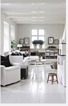 Black/white interiors with white floors.