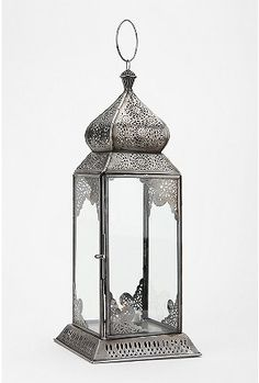 A bunch of these lanterns in different sizes on the kitchen table :o)