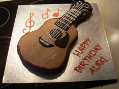 Accoustic guitar cake that is PERFECT for birthdays! So easy to do!!