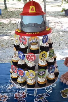 Rescue Bots cake and cupcakes by K Noelle Cakes