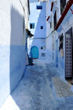 Cool blues in an alley in Chefchaouen, Morocco, via A Feminine Tomboy