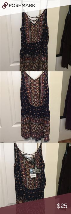 Angie Boho Romper Cute navy blue boho romper with hints of pink orange and green! Fits like a medium. NWT make an offer! Angie Dresses