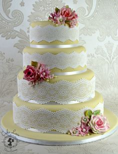 White embellished cake using Cake Lace. Available at Create and Craft - http://www.createandcraft.tv/cake-lace