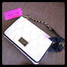 """Betsy Johnson Bone & Black Cross Body Purse Betsy Johnson bone and black cross body purse with chain and leather strap and pretty bow and gold heart embellishments. 8 3/4"""" across and 5"""" tall. New with tags. Betsey Johnson Bags"""