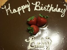 Triple Chocolate Ganache Cake with Coconut pecan filling with White Chocolate writing topped with fresh strawberries