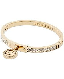 A sparkling crystal-decorated logo charm is suspended from a pave hinged bangle bracelet in this piece by Michael Kors. Available in silver-tone, gold-tone or rose gold-tone mixed metal. Michael Kors Schmuck, Michael Kors Armband, Michael Kors Bracelet, Michael Kors Jewelry, Bracelets For Men, Fashion Bracelets, Jewelry Bracelets, Bangles, Jewlery