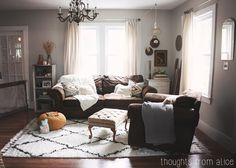 Love this cozy, neutral living room. It's full of texture and fun details.