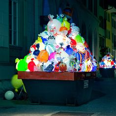 Plastic Garbage Guarding the Museum  by Luzinterruptus.  Plastic  carrier bags glow like lamps from within two skips thatSpanishlighting designersLuzinterruptushave placed at theentranceto the Gewerbemuseum in northern Switzerland.