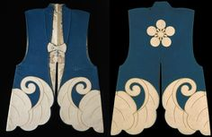 Jinbaori (war coat) for wearing over armor, wool felt with a stylized paulownia leaf design and the family crest design of the Maeda Daimyo in white wool felt and yellow silk chain stitching,  floral patterned silk brocade interior with gold thread, in tones of blue, mauve, yellow, green and black against a white ground, tortoise shell button. Made for the Maeda Daimyo or feudal lord of the Kaga fiefdom. Edo Period, 18th century. Los Angles county museum of Art.