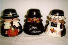 Pilgrims and Turkey in pot on telephone insulators