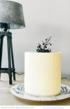 Simple and modern white cake on a ceramic plate