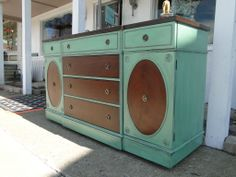 Large buffet in Soft Jade, distressed and glazed, stripped and stained top, some drawers and oval insets. Modern Vintage.