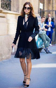 Christine Centenera wears a black blazer, skinny scarf, fringe skirt, statement choker, ankle-strap heels, and Céline sunglasses