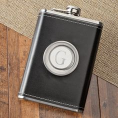 The personalized 8oz luxurious leather flask with folding shot glass is a perfect way to share your drink with your close friends. The flask holds 8 ounces of your favorite beverage. $31.00