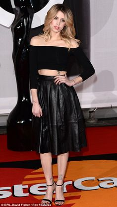 Doing it for the high street: Socialite Pixie Geldof wore black River Island, while Sophie Ellis Bextor opted for a Sixties-style dress