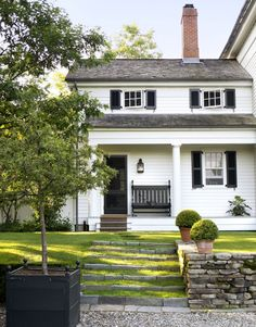 CURB APPEAL – another great example of beautiful design. white house with porch, black shutters + door. Modern Farmhouse, Farmhouse Style, Fresh Farmhouse, American Farmhouse, Farmhouse Garden, White Farmhouse, Farmhouse Design, Country Style, Farmhouse Addition