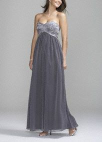 Back by popular demand, this dazzling gown features flashes of brilliance, perfect for any special occasion!   Exquisite beading adorns the fitted criss-cross strapless bodice.  Soft flowing chiffon creates a long lean silhouette as it gracefully drapes from the empire waist to the floor.  Fully lined. Back zip. Imported Polyester. Dry clean.  To protect your dress, our Non Woven Garment Bag is a must have!