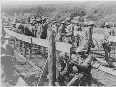 Americans belonging to the 89th Division of the IV Corps, who attacked the salient from the south, are seen here rolling barbed wire entanglements.