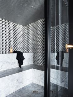 Modern steam room in the gym of The Barwon River House with marble mosaic walls from the Marmo by Greg Natale collection.