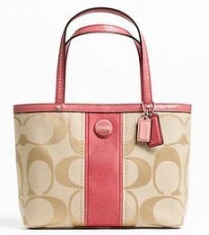 Coach-personally I think this is gaudy and ugly as all hell! It looks like a Coach knockoff or like Coach is changing their image to that of Betsy Johnson!