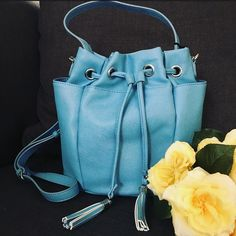 """Andie Bucket Bag in Blue Saffiano Andre bucket bag from Snob Essentials. Top handle and optional shoulder strap. Two external side pockets on either side and interior zip pocket. Approximately 9-3/4"""" L, 6-1/2"""" W, 10"""" H. 6-1/2 L handle drop with removeable 24-1/2"""" L cross body strap. Never been worn. Silver hardware. Also available in Green Croco   No trades.  No paypal. Instagram: @Jhennay262 Snob Essentials Bags Crossbody Bags"""