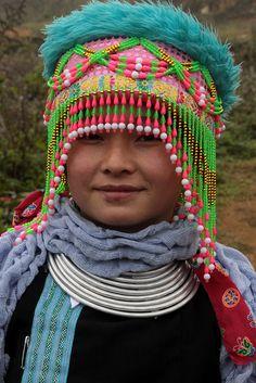 Vietnam - ethnic minorities   Hmong girl with traditional headgear.   © Walter Callens