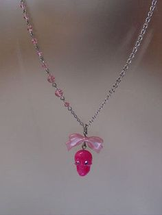 TARINA TARANTINO PINK SKULL WITH BOW  NECKLACE - http://elegant.designerjewelrygalleria.com/tarina-tarantino/tarina-tarantino-pink-skull-with-bow-necklace/