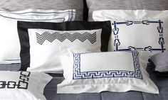 Clockwise from left: TAORMINA, SAVOY, CHEVRON BORDER, GIGLIO and MAZE shown on OPALINE quilt. Also shown are SOHO tweed Euro shams in back.