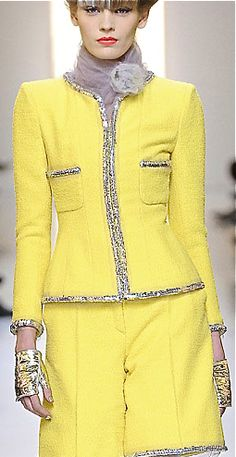 Chanel - Sweet and Sunny yellow with all the signature bells and whistles.