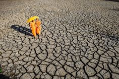 Dry weather conditions in Mekong Delta Vietnam. During the dry season, the land is rock-hard. There was enough well water for drinking and cooking in the rainy season, but in the dry season they lacked sufficient clean water.