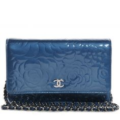 This is an authentic CHANEL Patent Camellia Wallet on Chain WOC in Blue. This stylish pochette wallet is crafted of camellia flower embossed patent leather.