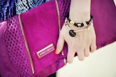 Jimmy Choo fuchsia leather clutch with perforated detailing.