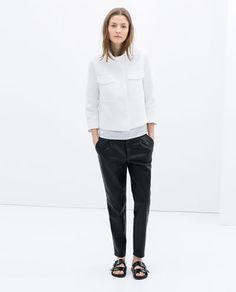 Image 1 of FUNNEL COLLAR SHORT JACKET from Zara
