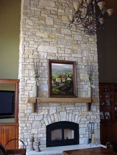 This fireplace uses Buechel Stone's Fond du Lac Custom Country Blend with cut stone for the custom surround and rock faced hearthstone. Visit www.buechelstone.com/shoppingcart/products/Fond-du-Lac-Cu... for more information.