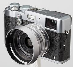 The new fuji X100T looks awesome http://www.adorama.com/alc/0014826/blogarticle/fujifilm-x100t-refines-the-hybrid-viewfinder-first-look?KBID=72337