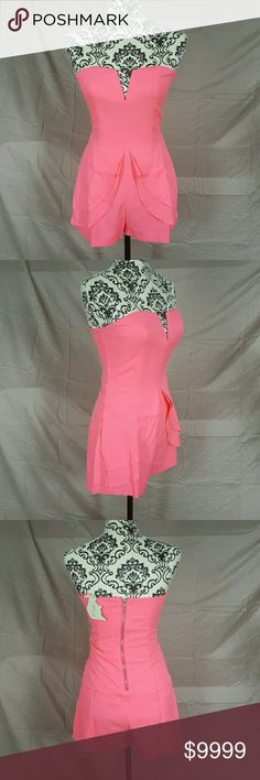 """Pink Strapless Peplum Romper Size Large. Strapless pink romper by Tea & Cup. Front skirted overlay. Slit pockets on the sides and back. Back zipper. There is a very slight stretch to it but not much.  💘Measurements: Bust-17.5"""" Waist-16"""" Hips-20"""" Tea n Cup Dresses"""