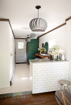 I've looked up concrete countertops and wonder if they might be used somewhere in our basement kitchen.  Love the look along with walnut coloured wood counters.  I wonder if I could continue the white subway tile with grey grout somewhere in the craft/kitchen area.  I'm loving the green chalkboard wall here.  Like it better than black in this photo.