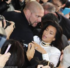 Dramatic scenes: Kim Kardashian was almost pulled to the ground by red carpet gate crasher...