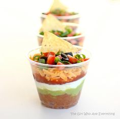Individual Seven Layer Dips! What a great party idea. I'm thinking it would be fun to create mini Frito Pies like this, too. Fritos, Chili, Shredded Cheese and other yummy toppings. Right?!