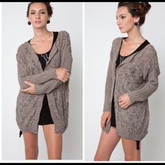 Buttons up knitted cardigan/sweater NWOT. Rich texture and a flattering long length make this cardigan/sweater the perfect transitional layer for this season. Flowing style and a relaxed fit for comfort and ease. Easy button front washable soft acrylic jersey knit. Sweaters Cardigans