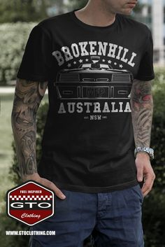 "Mad Max Inspired Broken Hill 1981 Men's T-Shirt showing the last of the V8 Ford Falcons printed on the front surrounded by a ""Broken Hill"" lettering. Broken Hill is where it all happened in the year 1981 and we thought we pay some tribute to this small but important Australian town out there in the outback of NSW. Custom made design from www.gtoclothing.com with attention to details. The must have for every Mad Max fan out there as well as Muscle Car lovers around the world…"