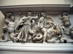 On the left, goddess Hecate is fighting the giant Clytius (she fights in three incarnations with a torch, a sword, and a lance) ; on the right, Artemis is fighting with a bow and arrow against a Giant (perhaps Otos), while on the ground her hunting dog kills another Giant with a bite to the neck. Pergamon Zeus Altar frieze (Gigantomachy) ; 2nd century BCE; Pergamon Museum in Berlin.