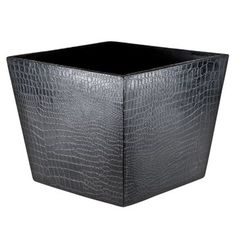 Alligator Square Wastebasket. For the person who has everything, this resin wastebasket is an opulent addition to the home office. Functional yet striking, Mónica Calderón's sophisticated décor will bring high drama to the home or office. MXN 1,625.00