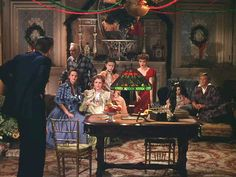 """""""Meet Me in St. Louis"""" Movie House.  In this scene, the family gathers to discuss the move to New York City. The dad, played by Leon Ames, has decided not to take the job in New York after all because he realizes how important home is to his family.  Pinned from Hooked on Houses, 12-25-2015."""