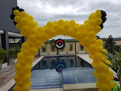 Pikachu archway for this Pokemon party (with our custom Pokeball sculpture in the background!)