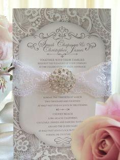 Lace Wedding Invitation With Jewel Embellishment. Lace ribbon, ornate jewel embellishment and lace printed back.  #lace #wedding #invites #laceribbon #jewel #embellishment #crystal #vintage